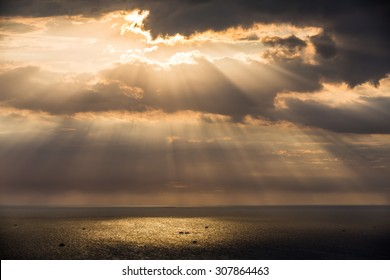 Crepuscular sun rays during sunset over the sea, Thailand