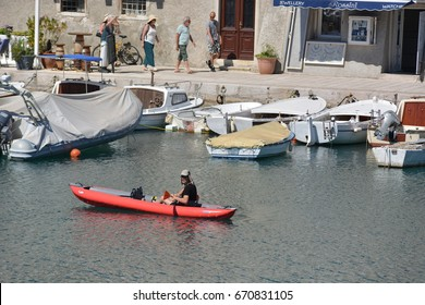 Cres, Croatia - June 19, 2017 - City of cres with kayak