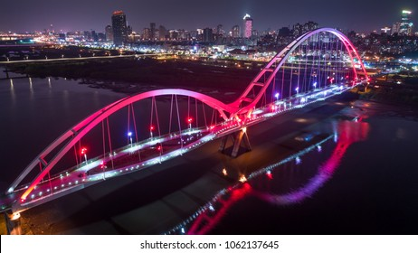 Crescent Bridge - Famous landmark of New Taipei, Taiwan with beautiful illumination at night, aerial photography in New Taipei, Taiwan.