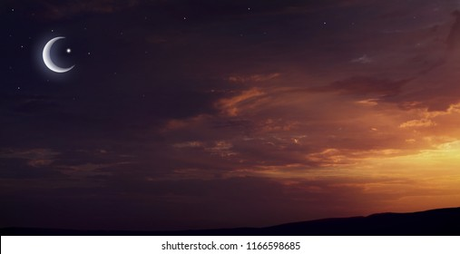 Crescent moon with beautiful sunset background .  Light from sky . Religion background . Red sunset and moon . Against the background of clouds .  Yellow and pink clouds . Sunset and new moon . Prayer