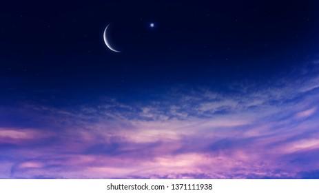 Crescent moon with beautiful sunset background . Generous Ramadan . New moon