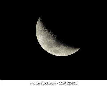 crescent moon with detailed surface, under the night sky, observed in the southern hemisphere, sao paulo, brazil