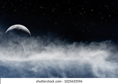 A crescent moon rising above a swirling mass of clouds and fog with nightime stars in the background sky.
