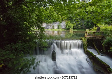 Cressbrook Weir and a millpond, in the Peak District, Derbyshire