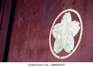 Crest of cherry blossom on the door of Japanese shrine