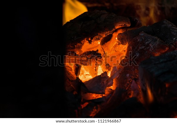 Crest of flame on burning wood in fireplace. Burning firewood in a Russian stove.