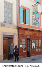 CREST, FRANCE, June 19, 2018 : People in the old streets of the city of Crest, in Drome region of the South of France.
