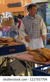 CREST, FRANCE, June 19, 2018 : The baker at the street market of the city of Crest.
