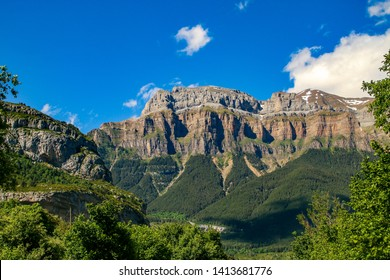 The crest of the Mondarruego in the Spanish Pyrenees seen from the Spanish town of Torla-Ordesa, Huesca, Spain. Natural landscape in the famous valley of Ordesa.