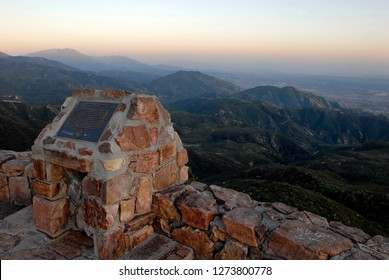 Crestline, California - April 15, 2015: View from Rim of the World Scenic Byway in the San Bernardino mountains and plaque to Donald S. Wieman, responsible for the masonry walls built in the 1930s.