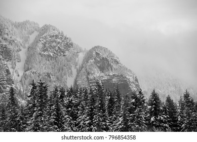 Creston Valley, British Columbia, Canada.  Portion of the Skimmerhorn on the east side of the valley in winter in black and white.