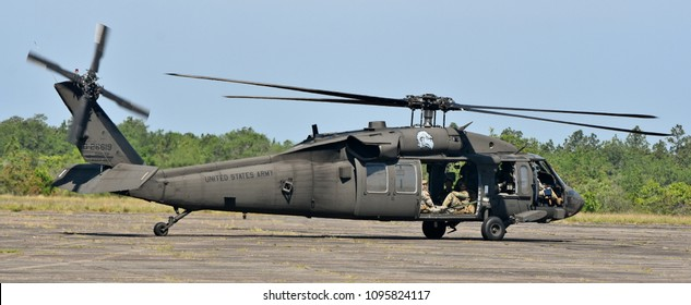 Crestview, Florida, USA - May 5, 2018. A Sikorsky UH-60 Blackhawk operated by the Army Rangers lands on a runway in Florida.