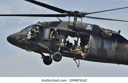 Crestview, Florida, USA - May 9, 2015: Army Rangers fly in a UH-60 Blackhawk as part of a airborne training exercise.