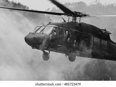 Crestview, Florida, USA, May 9, 2015 - A Sikorsky UH-60 Blackhawk operated by the Army Rangers lands on a runway in Florida (black and white).