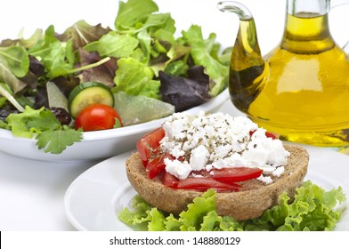 cretan recipe(dakos),roasted bread with  tomato cubes and feta cheese , green salad and olive oil