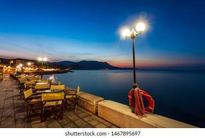 Crete, Greece - April 25 2018: Restaurant at Paraliaki promenaad at night in Kissamos, Crete, Greek Islands, Greece, Europe