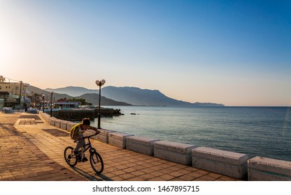 Crete, Greece - April 25 2018: Boy riding bike at Paraliaki promenaad, Kissamos, Crete, Greek Islands, Greece Europe