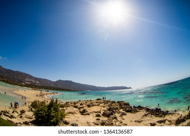 Crete, Greece, August 2018: People on pink sand beach of famous Elafonisi