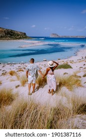 Crete Greece, Balos lagoon on Crete island, Greece. Tourists relax and bath in crystal clear water of Balos beach. Greece, couple men and woman visiting the beach