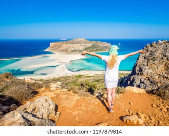 Crete, Greece: Blonde beautyful girl enjoying the beautiful views of Balos lagoon. Lagoon of Balos is one of the most visited tourist destinations on west coast of Crete.