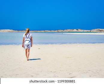Crete, Greece: Blonde beautyful girl enjoying the beautiful crystal clear sea of Balos lagoon. Lagoon of Balos is one of the most visited tourist destinations on west coast of Crete.