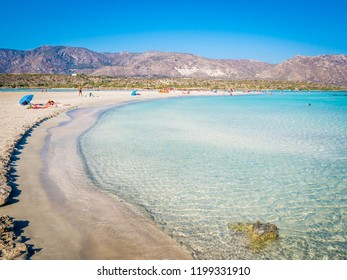 Crete, Greece - Jul 14, 2018: Elafonisi, a paradise beach with turquoise water, an island located close to the southwestern corner of the Mediterranean island of Crete, known for its pink sand beaches