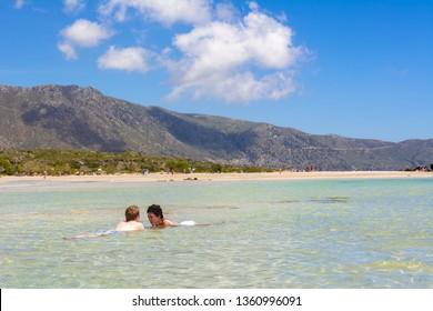 CRETE, GREECE - May 2, 2015: Tourists relax on the Elafonisi beach. Crete, Greece. Europe