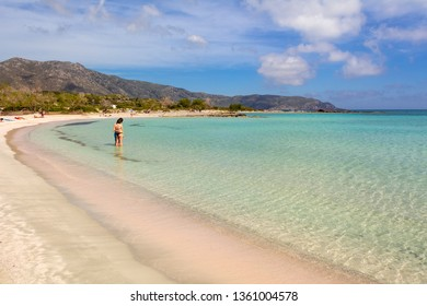 CRETE, GREECE - May 2, 2015: Elafonisi beach with pink sand, warm and crystal clear water. Crete Island, Greece