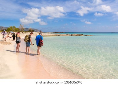 CRETE, GREECE - May 2, 2015: Tourists visit Elafonisi beach with pink sand, warm and crystal clear water. Crete Island, Greece