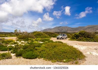 CRETE, GREECE - May 2, 2015: Suzuki Jimny car parked on Elafonisi beach. Island of Creta, Greece
