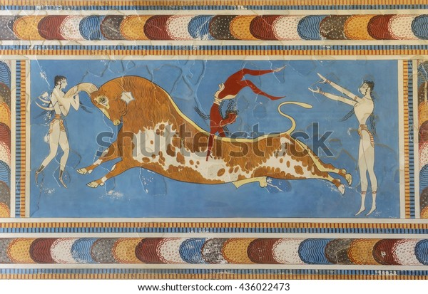 CRETE, GREECE - MAY 29, 2016: Famous a bull-leaping scene, two white-skined women and a brown-skined man from the Knossos Palace, 1600-1450 BC.