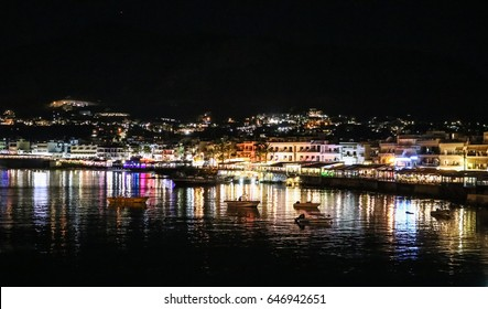 Crete, Greece - May 5, 2017. Beautiful night panorama of the waterfront in the city of Hersonissos.