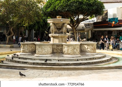 CRETE, GREECE - November, 2017: Heraklion, Lion Fountain or Morozini Fountain, built in 1628 during Venetian Period. Ornate Venetian fountain with four lions with water gushing from their mouths