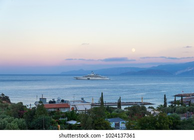 CRETE, GREECE - october 4, 2017: the most expensive yacht Eclipse with sunset and full moon in background near Crete, Greece