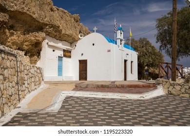 Crete / Greece - September 27, 2018: Small chapel on the seashore. Church at the port in the city of Hersonissos, Greece. Crete island.