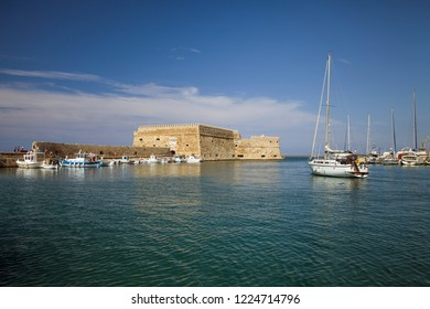 Crete, Heraklion / Greece - September 27, 2018:Boats and motorboats under the walls of Koules Fortress in Heraklion.Fortress on the sea, tourist attraction of the city of Heraklion.