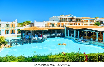CRETE ISLAND, GREECE, JULY 01, 2011: View on Royal Mare Village restaurant for tourists, guests. Restaurant patio pool. Classical Greek hotel architecture. Greece islands holidays tours tourist travel