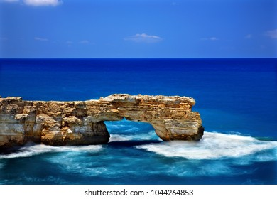"CRETE ISLAND, GREECE. The Kamara (literally ""arch"") of Geropotamos, a natural rocky ""bridge"" in an area also known as ""blue caves"", Rethymno prefecture."