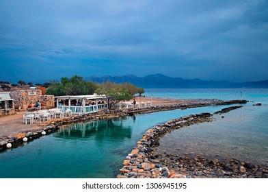 "CRETE ISLAND, GREECE - May 18, 2018. Kanali (literally ""Canal""), Elounda, gulf of Mirabello, Agios Nikolaos municipality, Lasithi prefecture."