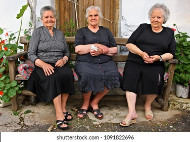 CRETE ISLAND, GREECE- May 23, 2015. Beautiful old ladies sitting and chatting at Avdou village, Hersonissos Municipality, Heraklion prefecture.