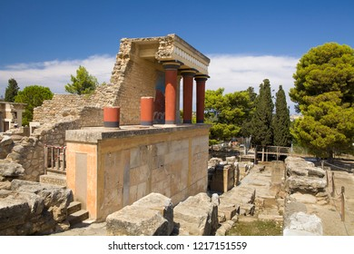 Crete, Knossos / Greece - September 27, 2018: Red columns of the Knossos palace. Knossos palace on the island of Crete in Greece. Ancient ruins of the burning part of the Archaeological Museum in Hera
