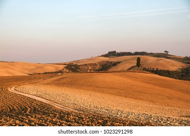 Crete Senesi, Asciano, Siena, Tuscany, Italy. Sunset, Summer.