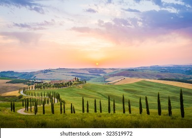 Crete Senesi, Tuscany, Italy. A lonely farmhouse with cypress and olive trees, rolling hills, Tuscany, Italy. A lonely farmhouse with cypress and olive trees, rolling hills.