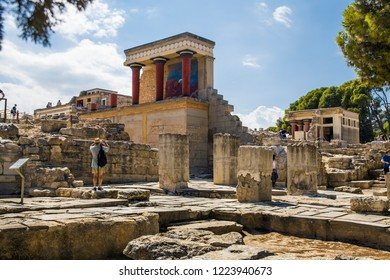 Crete/Greece - September 27, 2018: Palace in Knossos with red columns. Knossos palace on the island of Crete in Greece. Ancient ruins of the burning part of the Archaeological Museum in Heraklion.