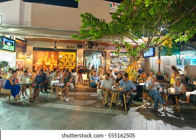 CRETE,HERAKLION-JULY 24: Greek nightlife, people in a local restaurant on Lions Square enjoy drinks on July 24,2014 on the Cete island, Greece.