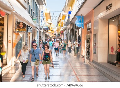 CRETE,HERAKLION-JULY 25: Shopping street Dedalou full of people during the midday on July 25,2014 in Heraklion on Crete, Greece. Daidalou Street is a paved pedestrian area lined with tourist shops.