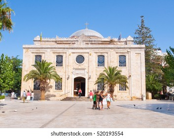 CRETE,HERAKLION-JULY 25:The basilica of St. Titus during the midday, tourists go sightseeing on July 25,2014 in Heraklion on the Crete island, Greece.