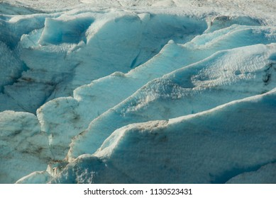 Crevasses in Portage Glacier showing the deep blue of compact ice.