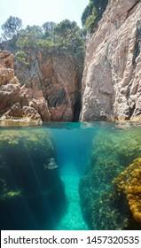 Crevice on rocky coast, split view over and under water surface, Mediterranean sea, Spain, Costa Brava, Aigua Xelida, Palafrugell, Catalonia