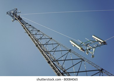 Crew installing boom with antennas on the cell tower